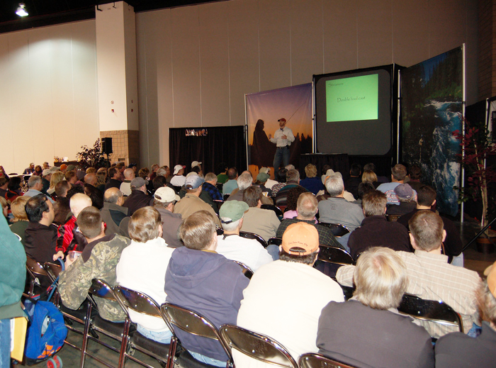 A substantial crowd listens to Landon Mayer explain his tips and tricks for fly fishing success.